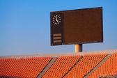 Scoreboard and bleachers — Stock Photo