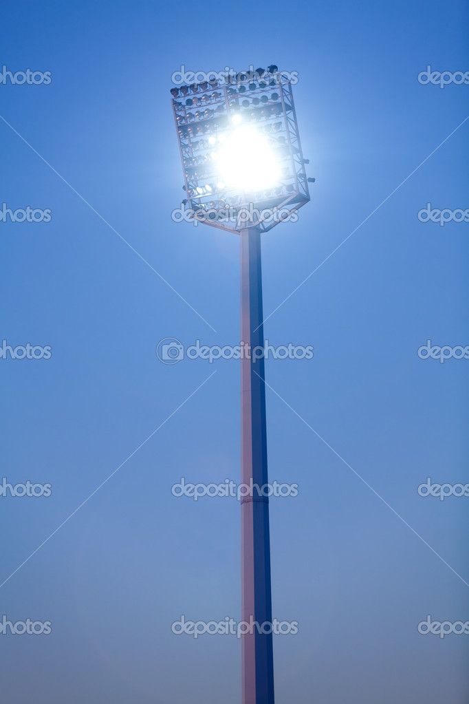 Stadium lights in daytime against blue sky — Stock Photo #9352011