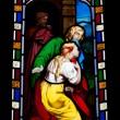 Religious stained glass window — Stockfoto