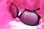 Boa and sunglasses — Stock Photo