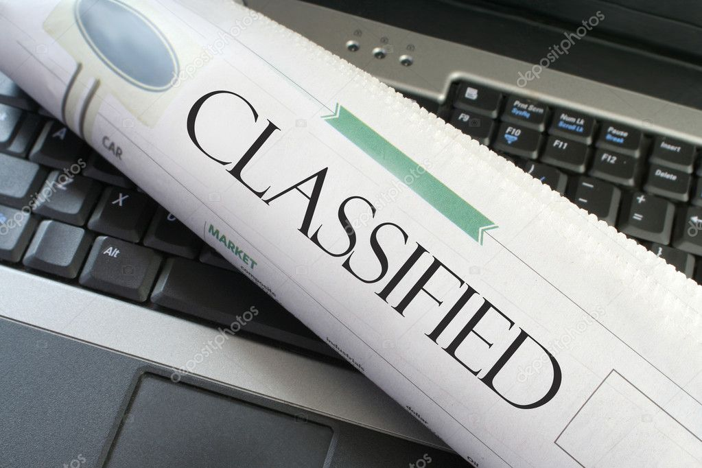 Classified headline section of the newspaper on a laptop computer — Lizenzfreies Foto #7973804
