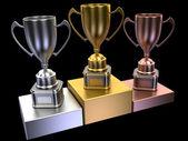 Podium with cups — Stock Photo