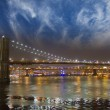 Manhattan Panorama, view at night with office building skyscrape - Stock Photo
