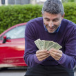 Stock Photo: Making Money Selling Cars