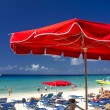 Royalty-Free Stock Photo: Red Beach Umbrellas and turquoise Waters of Caribbean