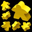 Royalty-Free Stock Vector Image: Yellow wooden Meeple vector set isolated on black.