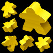 Yellow wooden Meeple vector set isolated on black. - Stock Vector