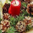 Candle in the Christmas fir-cone wreath — Stock Photo