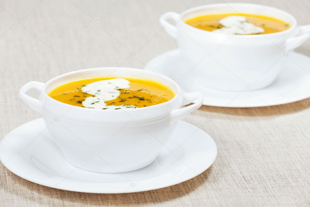 Fresh pumpkin cream soup with cream  Stock Photo #8080270