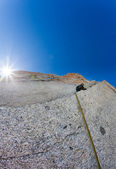 Climber on a steep rock wall — Stock Photo