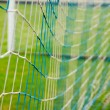 Mesh football goal on the stadium — Stok fotoğraf