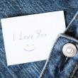 "Blue jeans with with hand printed card ""i love you"" — Stock Photo"