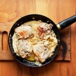Stock Photo: Fatty meat fried in skillet
