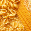 Close up shoot of different types of raw pasta. — Stock Photo #9000187
