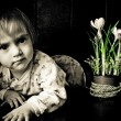 Royalty-Free Stock Photo: Child and  the spring flowers crocus