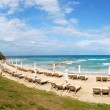 Panorama of a beach and turquoise water at the modern luxury hot - Stock Photo