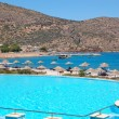 Swimming pool near beach at the modern luxury hotel, Crete, Gree - Stock Photo
