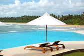 Sunbeds at the sea view swimming pool, Bentota, Sri Lanka — Stock Photo