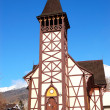 The old wooden Catholic church at ski resort, Tatranska Lomnica, - Stock Photo