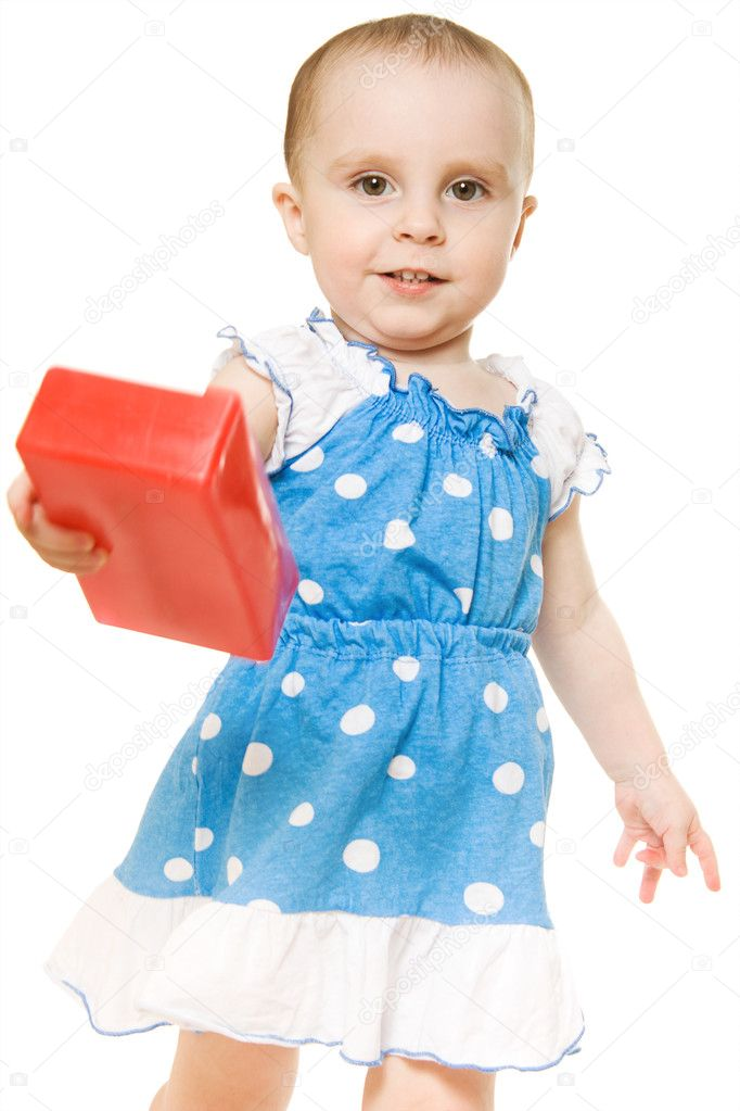 Baby playing with colourful blocks on a white background.  Stock Photo #10463144