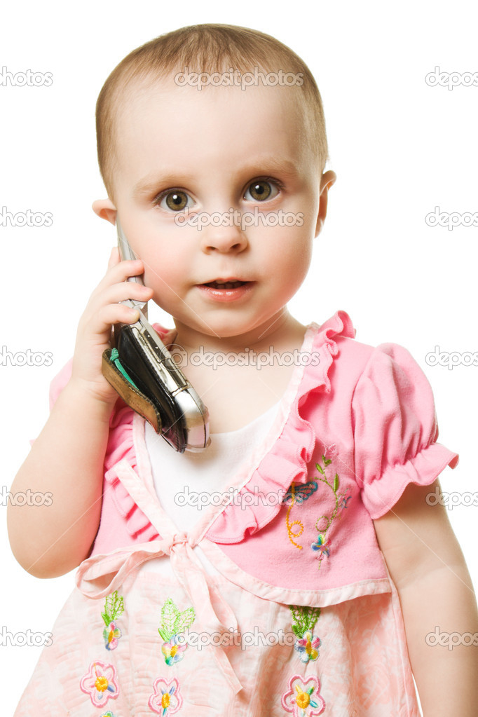 Little girl talking on the phone in a pink dress on a white background. — Stock Photo #10463719