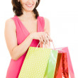 Girl with shopping in the red dress on white background. — Stock Photo #8145960