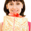 Happy woman with gift on a white background. — Foto Stock