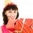 Happy woman with gifts on a white background. — Stock Photo