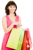Girl with shopping in the red dress on white background. — Stock Photo