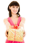 Happy woman with gift on a white background. — Stock Photo