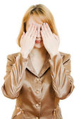 Businesswoman covers hands both eyes, isolated on white — Stock Photo