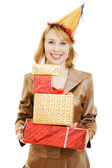Happy business woman in a festive hat with gifts in hand on white backgroun — Stock Photo