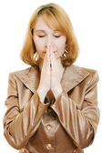 Praying woman in business suit with gold on a white background. — Stock Photo