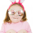 the little girl with pink ears and a rabbit wearing glasses on white backgr — Stock Photo