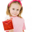 The little girl with pink ears bunny with a gift on a white background. — Stock Photo