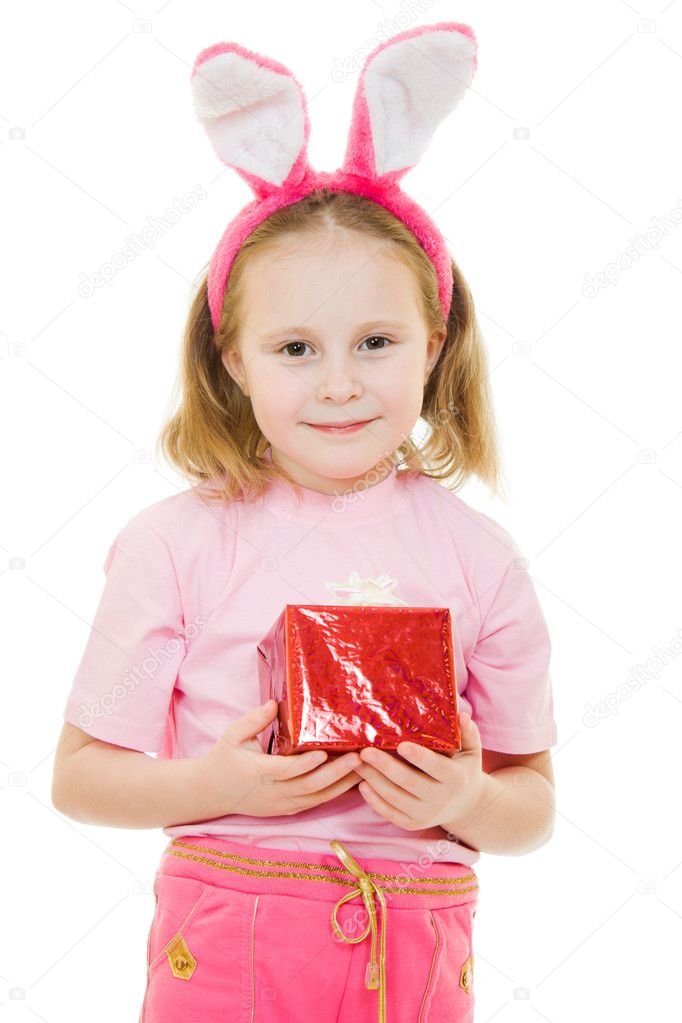 The little girl with pink ears bunny with a gift on a white background. — Stock Photo #8787769