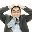 Businessman in distress on a white background. — Stock Photo