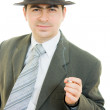 A businessman in a hat smokes on a white background. — Stock Photo