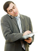 Businessman writing on the tablet pen on a white background. — Stock Photo