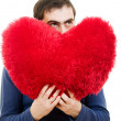 A man holding a big red heart on a white background. — Stock Photo