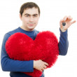 A man holding a big red heart and key on a white background. — Stock Photo