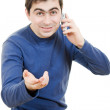 Portrait young man talking on cell phone on a white background — Stock Photo