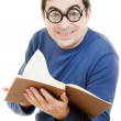 Описание:Student in glasses reading a book on white background — Stock Photo #9022733