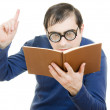 Описание:Student in glasses reading a book on white background — Стоковая фотография