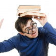 Student in glasses with a book on her head on white background — Stok fotoğraf