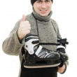 Men with skates gesture shows okay on white background. — Stock Photo #9023246