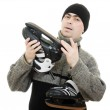 Man with skates on white background. — Stock Photo