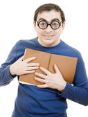 Student in glasses carefully pressed to his breast a book on white backgrou — Stock Photo