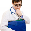 The doctor thinks in glasses on a white background. — Stock Photo #9231645
