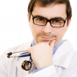 The doctor thinks in glasses on a white background. — Stockfoto